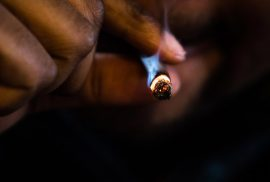 Close up shot of a man smoking a joint