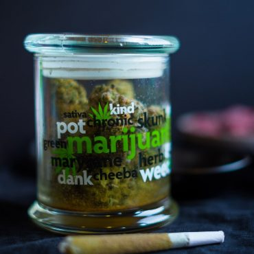 Jar full of Cannabis and Joint