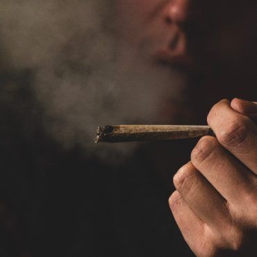 Person Smoking Joint