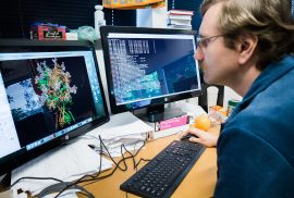 Standford Scientist Looking at a Protein on a Computer Screen